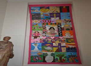 A banner to celebrate Joy and Peace at Christmastime, made from individual pieces of artwork by the 4th Years in 2012.