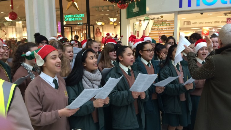 The school choir carol singing for charity in St, Stephen's Green Shopping Centre.