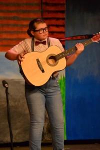 Dennis, playing his guitar