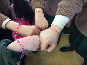 Student's hands displaying the female symbol.