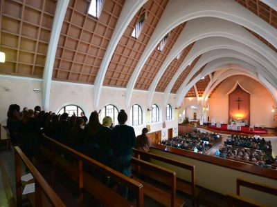 Shot of the choir singing to the congregation below.