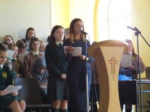 Chaplain Ms. Greham leading the service