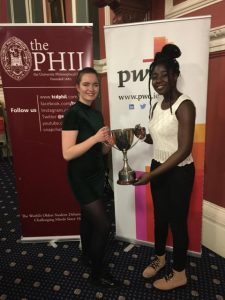 Ruth and Ciara with the Philspeaks trophy in Trinity College