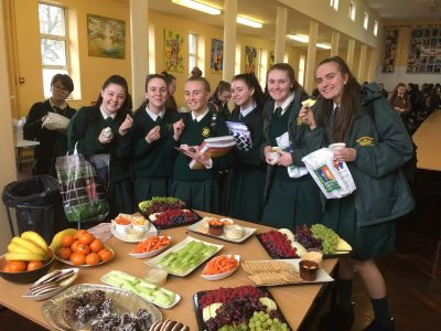 Students enjoying healthy snacks in the hall.