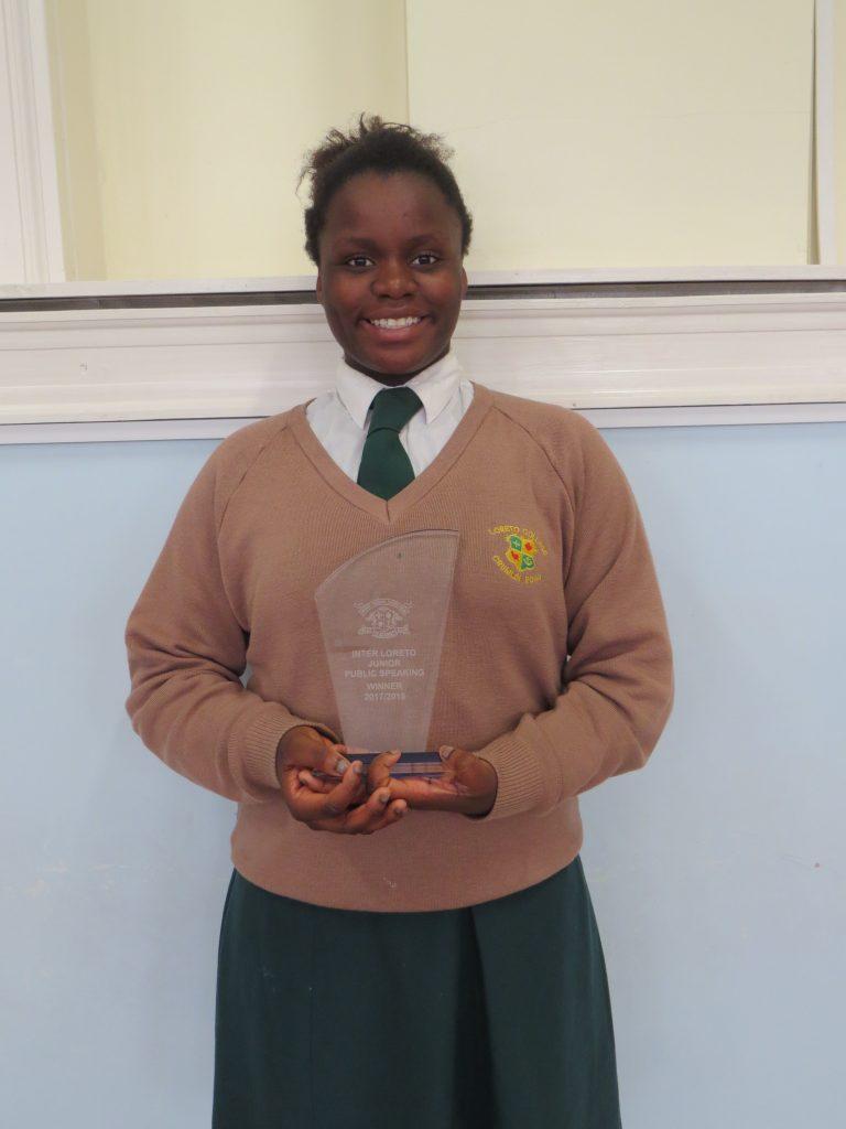 Ekenenna Chukwuewuzie with her trophy.
