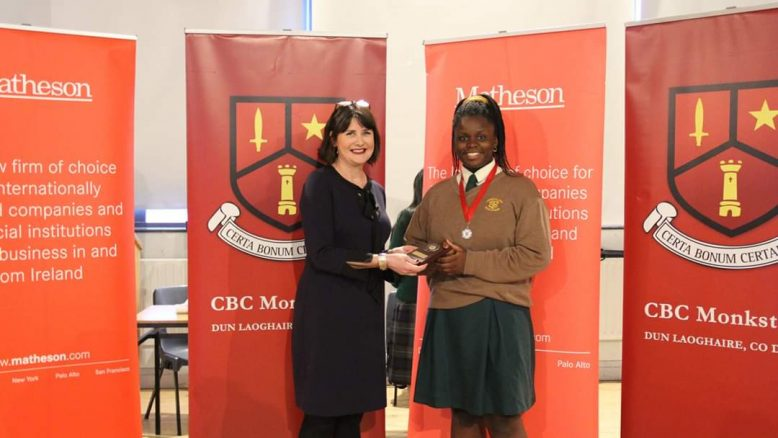 Ekenenna Chukwuewuzie being presented with her Best Speaker award by RTE's Keelin shanley.