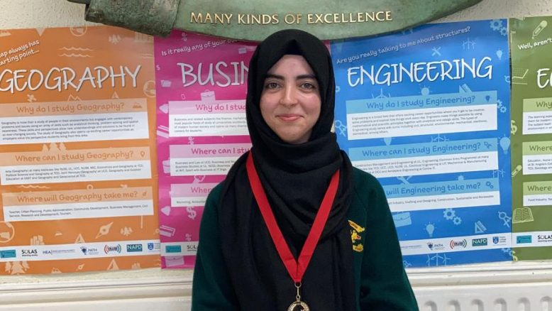 Zahra Benyala proudly wears her award for best New School Award at PE Xpo