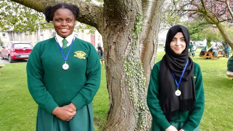 Ekenenna and Zahra proudly wear their medals.